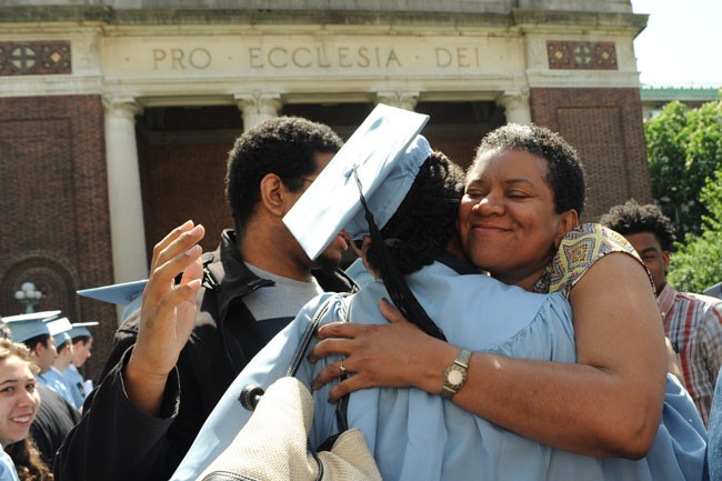 mother hugging graduate